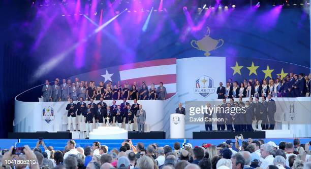 The United States and European Teams team stand during their national anthems during the opening ceremony for the 2018 Ryder Cup at Le Golf National...