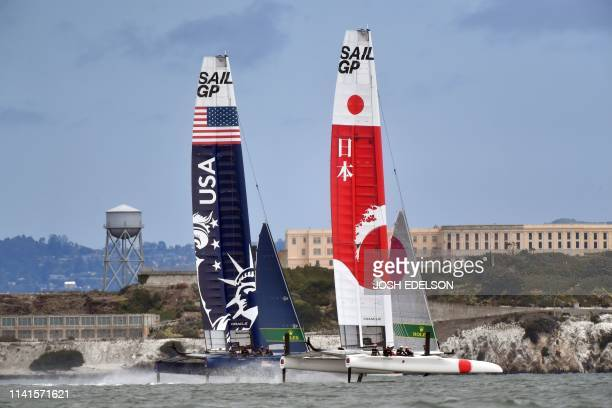 The United States and Japan SailGP teams pass by Alcatraz during the SailGP races on the San Francisco Bay in San Francisco California on May 5 2019...