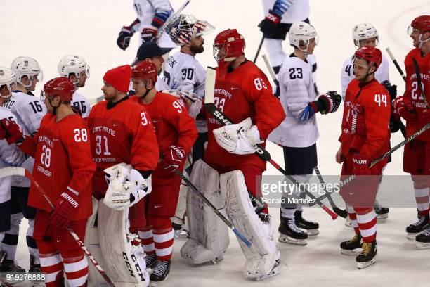 The United States and Olympic Athlete from Russia teams meet on the ice after Olympic Athlete from Russia defeated the United States 40 during the...