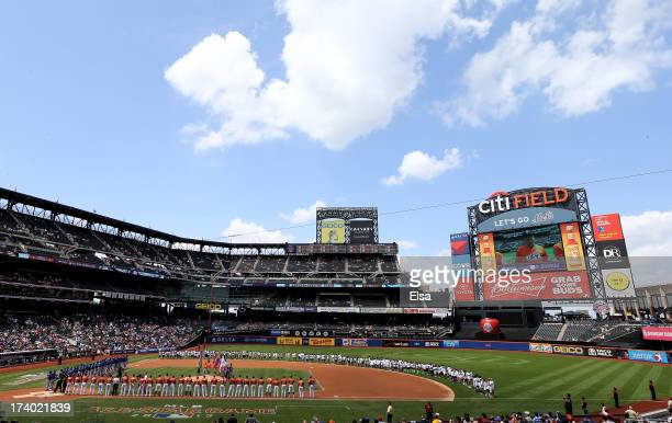 The United States and the World Team line up before the game on July 14 2013 at Citi Field in the Flushing neighborhood of the Queens borough of New...