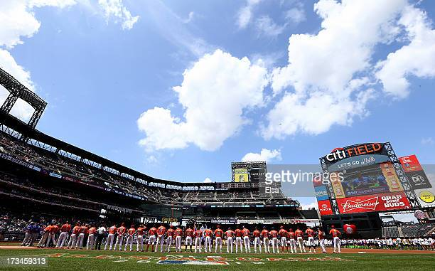 The United States and the World teams line up before the game on July 14 2013 at Citi Field in the Flushing neighborhood of the Queens borough of New...