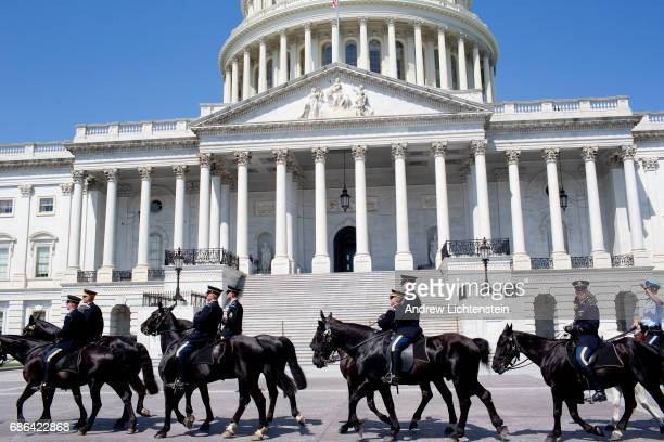 The United States army caisson unit rides past the Capitol on May 19 2017 in Washington DC