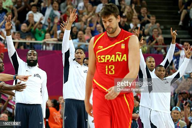 The United States bench celebrate as Marc Gasol of Spain shows his emotion in the Men's Basketball gold medal game between the United States and...