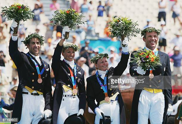 The United States bronze medal team of Robert Dover, Lisa Wilcox, Deborah McDonald and Guenter Seidel stand on the podium during the medal ceremony...