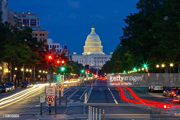 The United States Capitol Building as viewed with traffic from Pennsylvania Avenue. Taken on August 14, 2012 from Freedom Plaza in Washington, DC,...