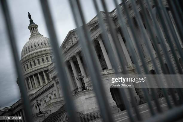 The United States Capitol is seen from behind a police barricade on October 16, 2020 in Washington, DC. With less than three weeks before the...