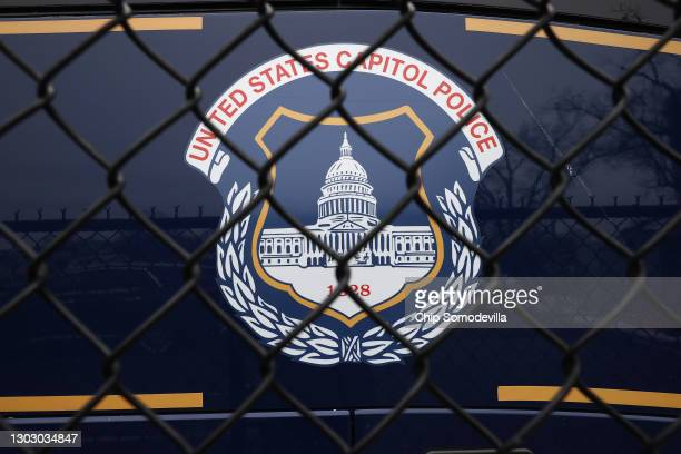 The United States Capitol Police seal appears on the side of a bus parked near the headquarters on February 19, 2021 in Washington, DC. The Capitol...