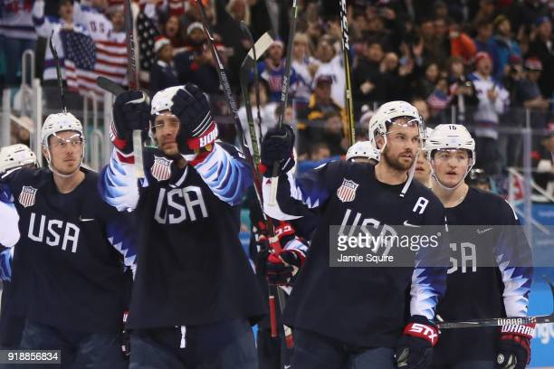 The United States celebrate after defeating Slovakia 21 during the Men's Ice Hockey Preliminary Round Group B game at Gangneung Hockey Centre on...