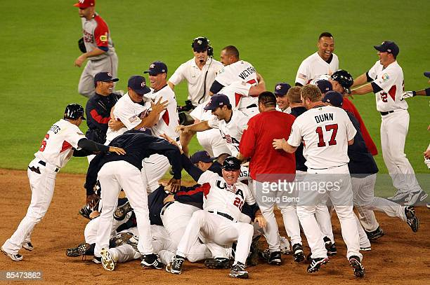 The United States celebrates after defeating Puerto Rico during day 4 of round 2 of the World Baseball Classic at Dolphin Stadium on March 17 2009 in...