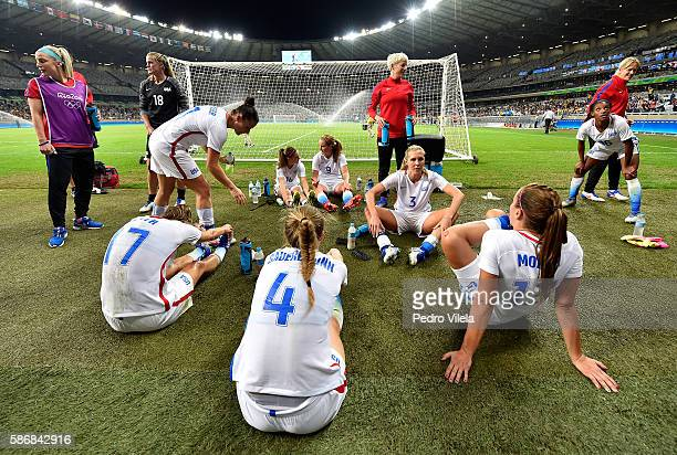 The United States celebrates after winning their Women's Group G first round match against France during Day 1 of the Rio 2016 Olympic Games at...