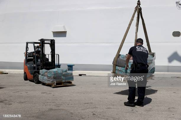 The United States Coast Guard offloads pallets of drugs from the Cutter James at Port Everglades on August 05, 2021 in Port Everglades, Florida....