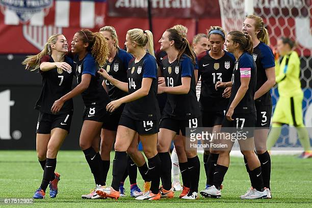 The United States congratulate teammate Kealia Ohai on her first goal with the national team against Switzerland during the second half of the...