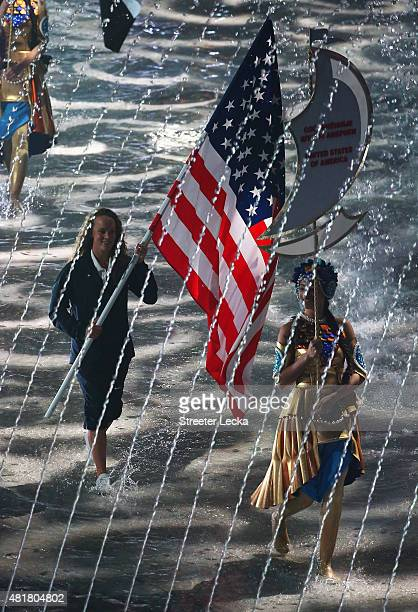 The United States flag bearer enters the arena during the Opening Ceremony of the 16th FINA World Championships at TatNeft Arena on July 24 2015 in...