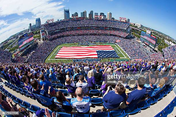 The United States flag covering the field before a game between the Tennessee Titans and the Minnesota Vikings at Nissan Stadium on September 11,...