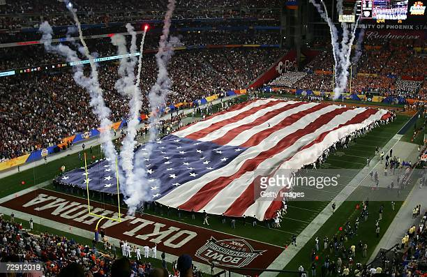 The United States flag covers the field during the national anthem before the Tostito's Fiesta Bowl between the Oklahoma Sooners and the Boise State...