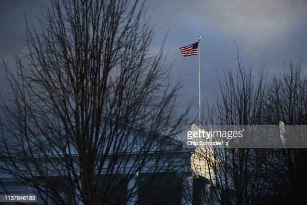 The United States flag flies over the White House shortly after special counsel Robert Mueller delivered his report on Russian interference in the...