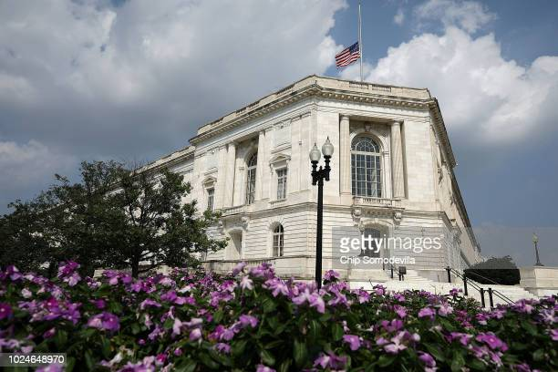 The United States flag flys at half staff over the Russell Senate Office Building on Capitol Hill in honor of Sen. John McCain August 27, 2018 in...