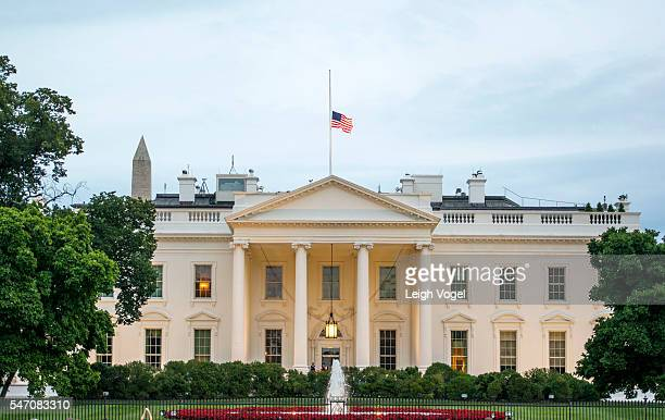 The United States flag is seen at half mast in honor of the fallen Dallas officers at The White House on July 12, 2016 in Washington, DC.