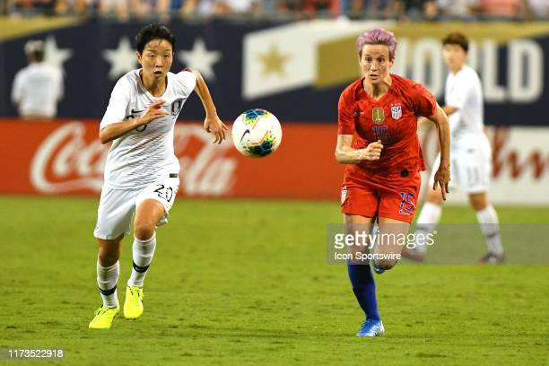 the United States forward Megan Rapinoe charges for the ball along with South Korea defender Kim Hyeri during the US Women's National Teams victory...