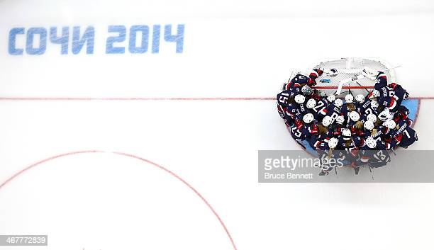 The United States gathers by their net before taking on Finland in the Women's Ice Hockey Preliminary Round Group A Game on day 1 of the Sochi 2014...
