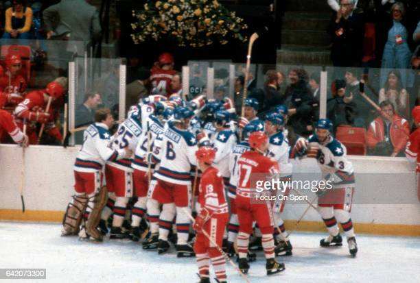 The United States Hockey team celebrates after they defeated the Soviet Union during a metal round game of the Winter Olympics February 22 1980 at...