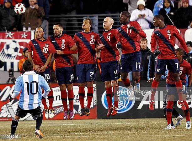 The United States lines up to defend a free kick by Lionel Messi of Argentina during the second half of a friendly match at New Meadowlands Stadium...