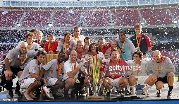 The United States menOs soccer team poses with the Gold Cup after defeating Panama on penalty kicks during the CONCACAF championship match on July 24...