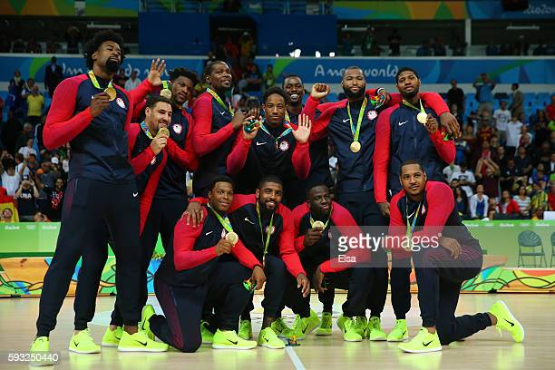 The United States Men's Basketball team celebrates with their gold medals after defeating Serbia in the Men's Gold medal game on Day 16 of the Rio...