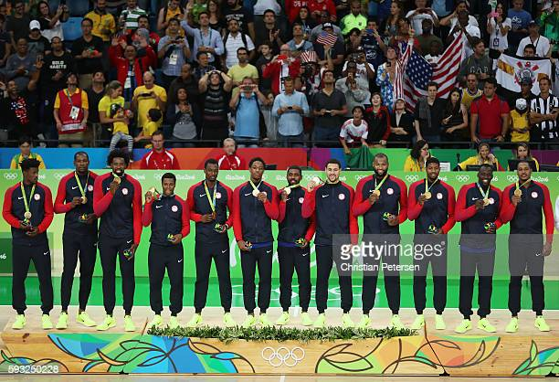 The United States Men's Basketball team looks on with their gold medals during the national anthem after defeating Serbia in the Men's Gold medal...