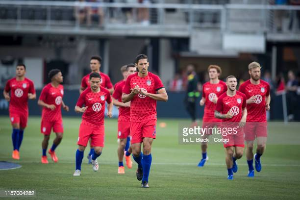 The United States Men's soccer team takes the field for warm ups during warm ups of the International Friendly match between the USA Men's National...