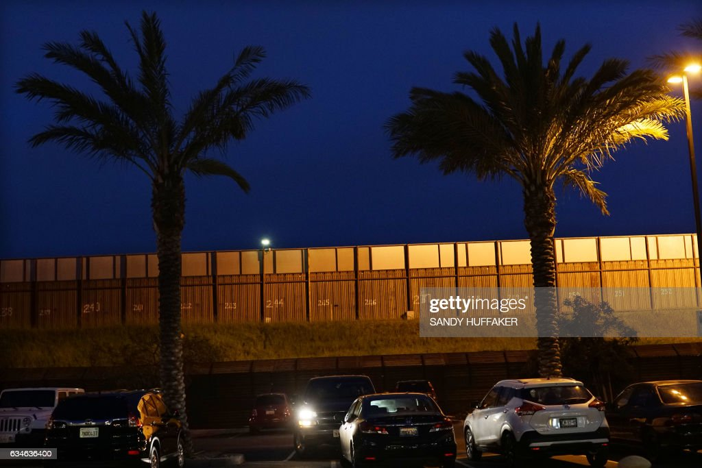 The United States - Mexico Border wall near the San Ysidro Port of Entry in San Ysidro, California on Friday, February 10, 2017. US Department of Homeland Security (DHS) Secretary John Kelly visited the San Ysidro Port of Entry February 10, 2017 in San Ysidro, California. / AFP / Sandy Huffaker