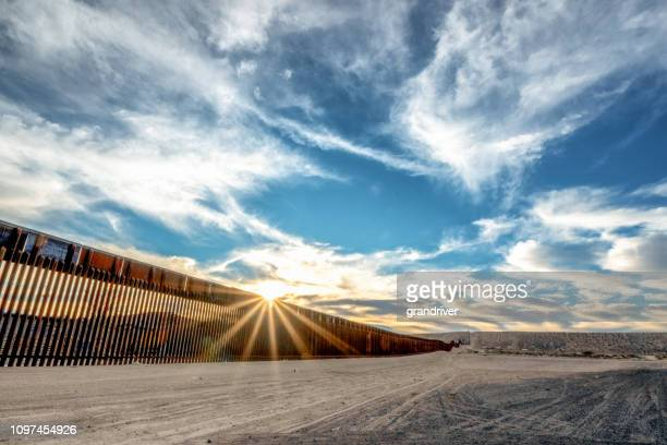 the united states mexico international border wall between sunland park new mexico and puerto anapra, chihuahua mexico - immigration stock pictures, royalty-free photos & images