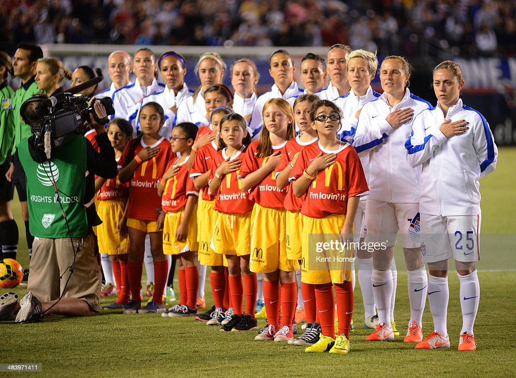 The United States national team lines up with honorary ball kids for the national anthem prior to the first half of the game against China during an international firendly match at Qualcomm Stadium on April 10, 2014 in San Diego, California.