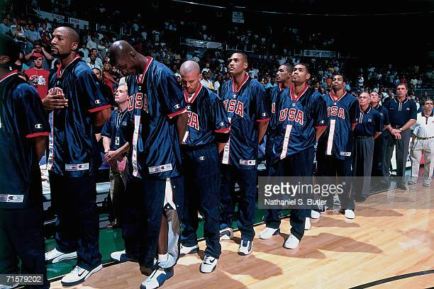 The United States National Team stands for the national anthem prior to competing against the Canadian National Team during a 2000 pre-Olympic...
