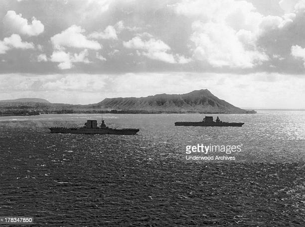 The United States Navy aircraft carriers the USS Lexington and the USS Saratoga in Mamala Bay with Diamond Head rising in the background Honolulu...