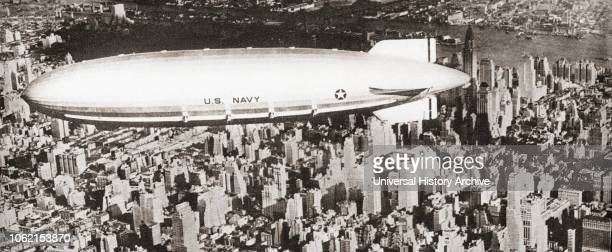 The United States navys helium-filled rigid airship USS Akron ZRS-4 seen here flying over New York City The Akron crashed into the sea off the coast...