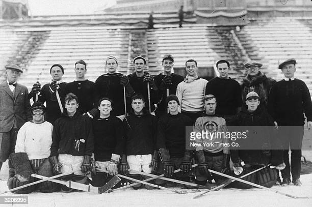 The United States Olympic ice hockey team poses at Lake Placid Stadium, New York. Bottom: Frank Farrell, Jack Bent, Buzz Hollock, John Cookman, Doug...