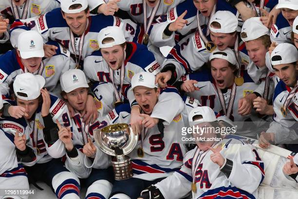 The United States pose for a team photo after defeating Canada during the 2021 IIHF World Junior Championship gold medal game at Rogers Place on...