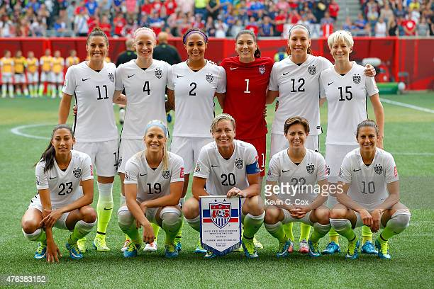 The United States poses for a team photo before the FIFA Women's World Cup 2015 Group D match against Australia at Winnipeg Stadium on June 8, 2015...
