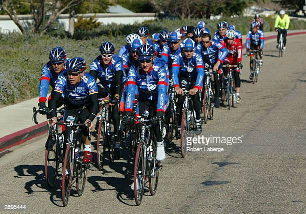 The United States Postal Service Cycling Team is followed by an amateur cyclist in training during Media Day January 23 2004 in the region around...