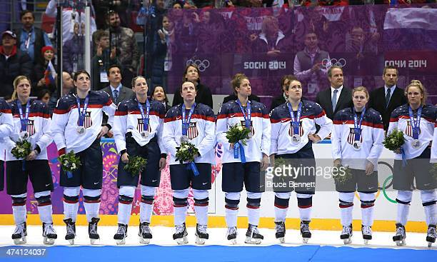The United States react during the flower ceremony after losing to Canada 32 during the Ice Hockey Women's Gold Medal Game on day 13 of the Sochi...