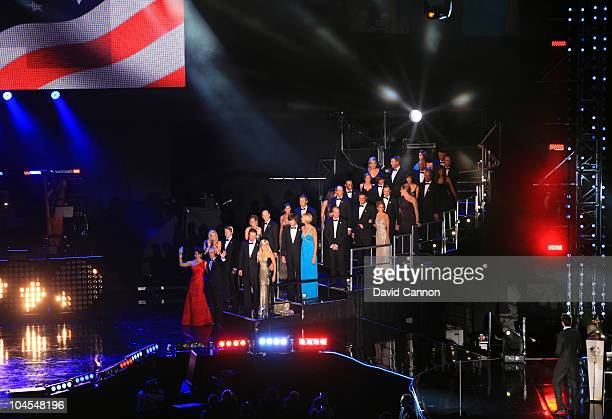 The United States Ryder Cup team led by captain Corey Pavin and his wife Lisa Pavin enter the stage during Welcome To Wales Concert at Millennium...