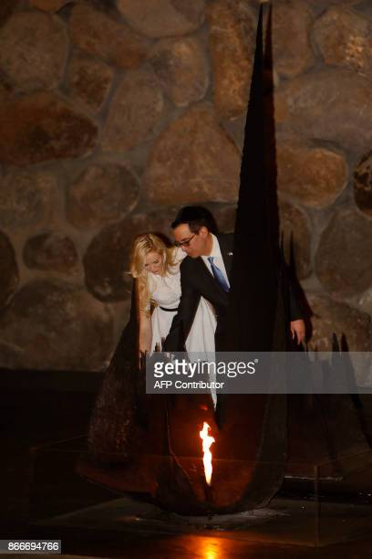 The United States Secretary of the Treasury Steven Mnuchin and his wife Louise Linton rekindle the eternal flame at the Hall of Remembrance on...