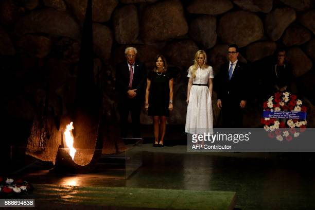 The United States Secretary of the Treasury Steven Mnuchin and his wife Louise Linton stand next to US ambassador to Israel David Friedman and his...