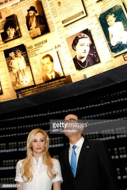The United States Secretary of the Treasury Steven Mnuchin and his wife Louise Linton look at pictures of Jewish Holocaust victims at the Hall of...