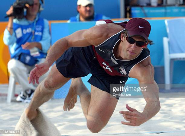 The United States Stein Metzger competes against Markus Dieckmann and Jonas Reckermann of Germany in the Men's Beach Vollyball Competition at the...