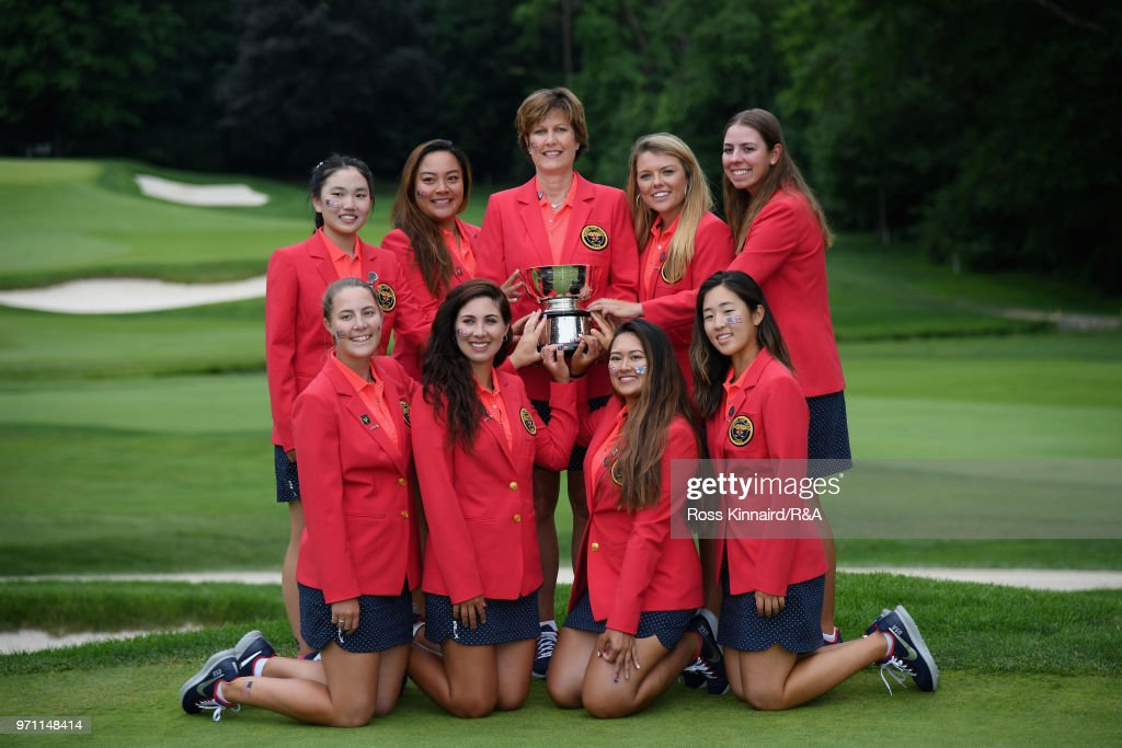 The United States team and Captain Virginia Derby Grimes celebrate with the Curtis Cup trophy after their 17-3 win over the Great Britain and Ireland team on day three of the 2018 Curtis Cup Match at Quaker Ridge Golf Club on June 10, 2018 in Scarsdale, New York.