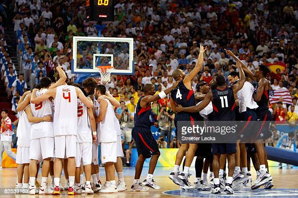The United States team and Spain huddle center court after the USA won the gold medal game 118107 during Day 16 of the Beijing 2008 Olympic Games at...