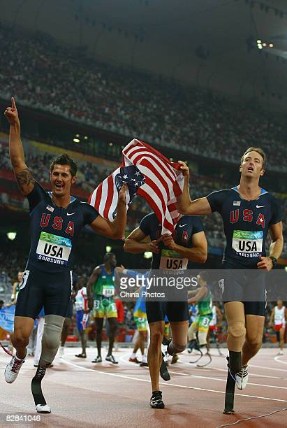 The United States team celebrate after winning the Men's 4x100m T42T46 Final Athletics event at the National Stadium during day ten of the 2008...