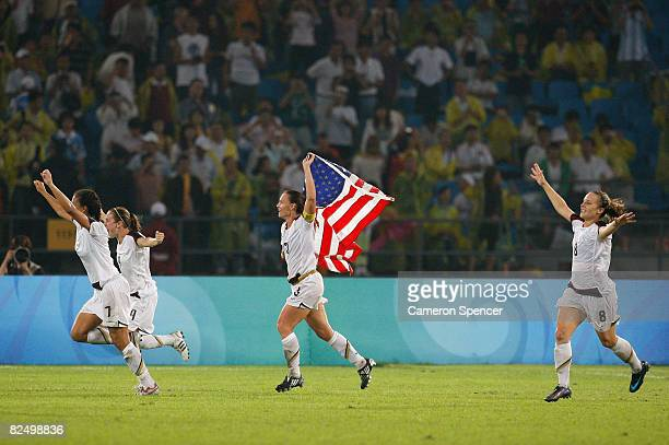 The United States team celebrate after winning the Women's Football Gold Medal match between Brazil and the United States 01 on Day 13 of the Beijing...